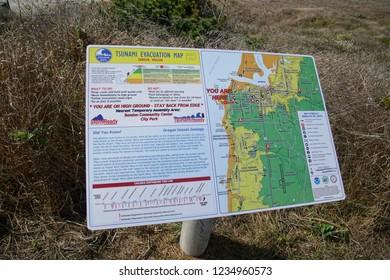 BANDON, OREGON - OCT 3, 2018 - Tsunami evacution sign on coastal Bandon, Oregon