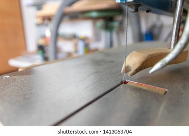 Bandsaw in a carpenters workshop ready to cut wood and create wooden furniture