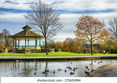 Bandstand and duck pond in Greenhead park, Huddersfield, Yorkshire, England