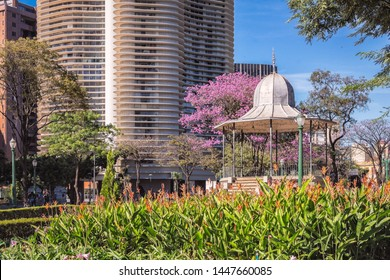 Bandstand and Niemeyer Building against a Blue Sky Background and a Pink Trumpet Tree in Liberty Square (Praça da Liberdade) on a Sunny Day, Famous Touristic Attraction