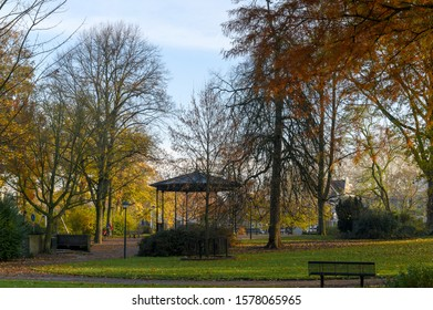 Bandstand in a park among the trees with Indian summer foliage.