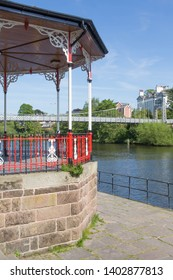 The bandstand and suspension bridge on the banks of the River Dee at Chester, England.