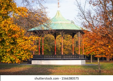 Bandstand with yellow coloured trees in Greenwich park during autumn season