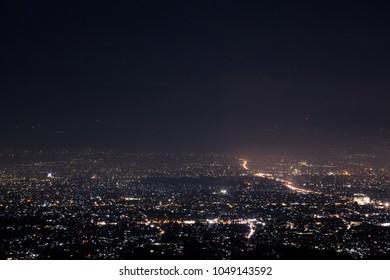 Bandung city night aerial view taken from Warung Moko