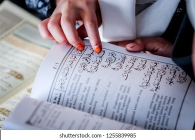 Bandung, Indonesia - 08th 04 2015: A Girl Learning to Read Quran in Arabic