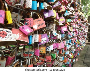 Bandung, INDONESIA - 15 NOVEMBER 2018 - The symbol of love, marriage and relationship with pad lock put on the wooden bridge in Farmhouse Bandung city on 15 November 2018