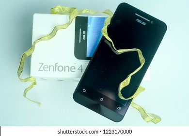 Bandung, Indonesia - 18th February 2015: Isolated Smartphone Asus Zenfone 4 on a White Background