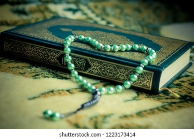 Bandung - Indonesia - 18th February 2018: Holy Qur'an and Prayer Beads on a Prayer Rug