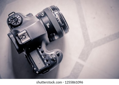 Bandung, Indonesia - 18th January 2015: Isolated Canon EOS 6D dSLR Camera with EF 50mm f/1.4 on a Table
