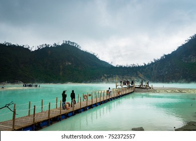 "Bandung, Indonesia 2017 - October 2017: Visitors at Kawa Putih, ""White Crater"" in Bandung, West Java, Indonesia. White Crater is a natural wonder in Indonesia visited by domestic and foreign tourists."