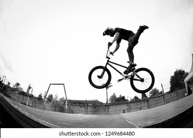 Bandung, Indonesia - 20th 12 2014: BMX Rider Jumping on a Ramp