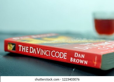 Bandung, Indonesia - 28th January 2015: Leisure Activity with Tea and Book The DaVinci Code from Dan Brown