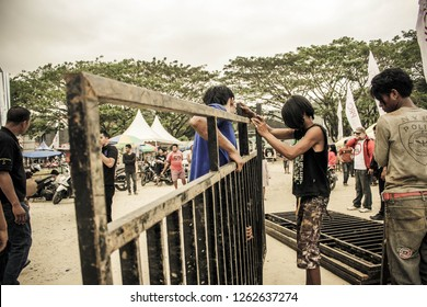 Bandung, Indonesia - 31st 08 2013: Men Installing Black Concert Metal Barricades