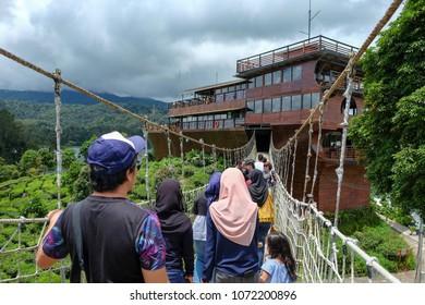 BANDUNG, INDONESIA - APRIL 19 2018 : Visitors approaching boat at glamping lakeside, Ciwedey, Bandung, Indonesia