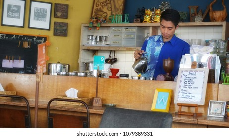 Bandung, Indonesia - April 2018 : A barista making coffee for his customer