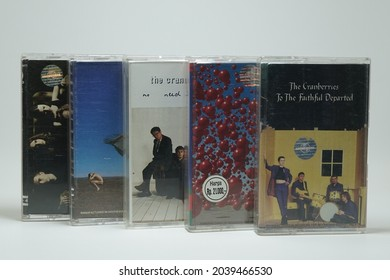 Bandung, Indonesia - August 11, 2021: A collection of cassette tapes from The Cranberries band that was popular in the 90s. Cassette tapes on white background isolated.