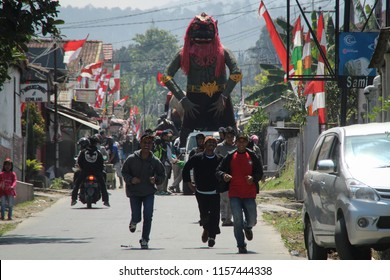 Bandung - Indonesia, August 16 2018: A number of residents carried 'Ogoh-ogoh' at carnival in Cihanjuang Rahayu Village, Parongpong District, West Bandung, Indonesia to celebrate independence day.