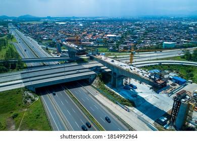 Bandung / Indonesia - August 16, 2020: Established Aerial View of Balance Cantilever Long Span Bridge Construction for the Jakarta-Bandung High Speed Train Project, Soroja Interchange, Pasir Koja