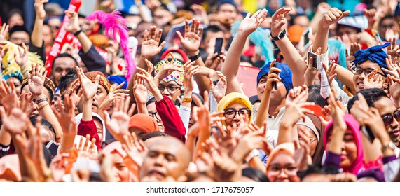 Bandung, Indonesia : A big crowd with lots of people cheering and excited (05/2016).