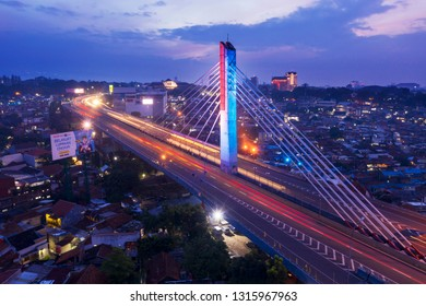 Bandung - Indonesia. January 03, 2019: Beautiful aerial view of light trails on Pasupati bridge overpass at dawn time in Bandung city
