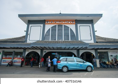 BANDUNG, INDONESIA - JANUARY 15 2016: Signboard entrance to Bandung Train Station and taxi driver with a passenger at Bandung, Indonesia.