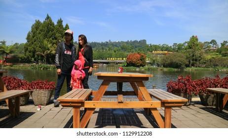 Bandung, Indonesia - July 7, 2018: Visitor taken photo near man-made lakes as Floating Market Lembang, West Java.