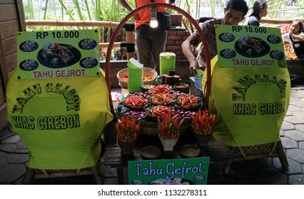 Bandung, Indonesia - July 7, 2018: Seller of Tahu Gejrot at Floating Market Lembang, West Java. Tahu Gejrot (fried tofu with chili soy sauce) is traditional food from Cirebon.
