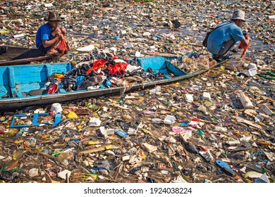 Bandung, Indonesia : People collecting plastic garbage in the Citarum River, the one of polluted river in Indonesia (05-2017).