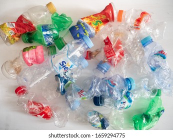 Bandung, Jawa Barat / Indonesia - February 29th, 2019: Mineral water and random bottles crushed and crumpled on a white background in Indonesia