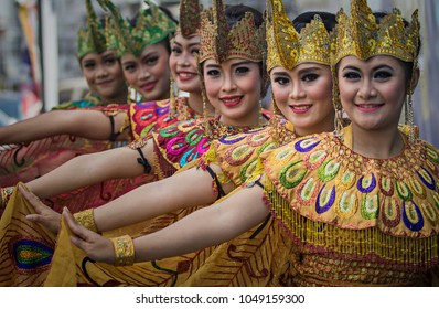 Bandung, West Java, Indonesia (12/13/2015), beautiful women, the dancers of Merak dance (a traditional dance of West Java Province), performing together in Merak Dance Festival.