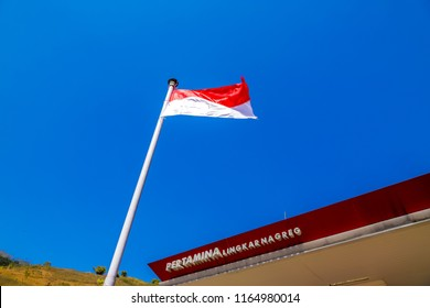 Bandung, West Java / Indonesia - August 19, 2018: Indonesian Flag (Merah Putih) at Pertamina Gas Station (Pom Bensin) Lingkar Nagreg with Blue Sky
