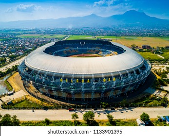 Bandung, West Java / Indonesia - July 12, 2018: Aerial View of Gelora Bandung Lautan Api (GBLA)  Football / Soccer Stadium in the Morning with Blue Sky