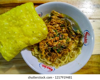 Bandung, West Java / Indonesia - October 14th 2018: Traditional Indonesian Chicken Noodles with Crackers (Mie Ayam Bakso Pangsit Goreng)