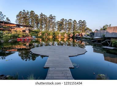 Bandung, West Java/Indonesia - 29th July 2015: A Wooden Dock with Lake View and Pine Forest in Dusun Bambu Bandung