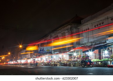Bandung, West Java/Indonesia - Feb 20, 2016: Traditional market shop at night in Bandung West Java. Taken with long exposure with traffic trailing lights.