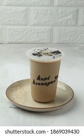 Bandung,Indonesia December07-2020:iced coffee milk from Kopi kenangan,soft focus