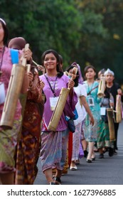Bandung-Indonesia, September 21 2017. girls are attending the carnival by bringing a kentongan or jidor, this tool is often used by local people to mark the call to prayer or danger
