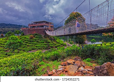 Bandung,Indonesia-February 12th,2017:Tourist were seen walking on the hanging bridge towards the ship like cafe in Patenggang Lake, Bandung. This is one of the famous tourist spot in Bandung.