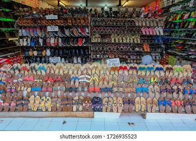 Bandung,Indonesia-February 12th,2017:Various types of shoes were sold at a cheap price on the street of Bandung City.This is one of the best place to do shopping activity in Indonesia.