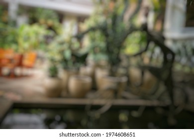 bandung,indonesia-may 10th,2021- defocused abstract background of fishpond with bicycle and woman statuesin in outdoor garden at rumah mode factory outlet, bandung,indonesia