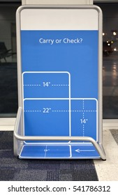 The bane of many an air traveler-the carry on measurement scale. Vertical.