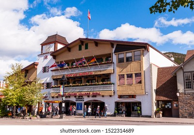 Banff, Alberta, Canada 9/24/2019 The Clock Tower Village Mall on Banff Avenue. A  three story building containing shops and a currency exchange