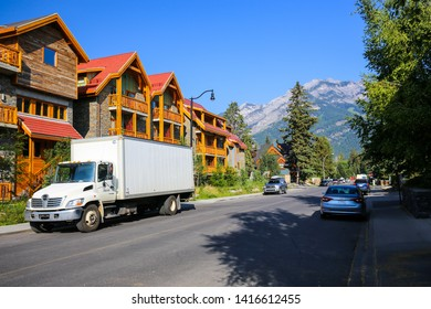 Banff, Alberta / Canada - July 30, 2018:  Townhomes and buildings in downtown Banff Village in the summer