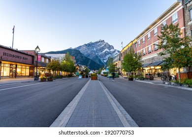 Banff, Alberta, Canada - SEP 07 2020 : Banff Avenue street view in summer evening, during covid-19 pandemic period not much tourists on the road. Banff National Park, Canadian Rockies.
