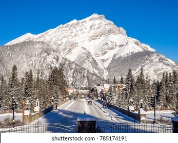 BANFF, ALBERTA - DEC 31: Banff Avenue in winter on December 31, 2017 in Banff National Park, Alberta, Canada. The avenue is the central shopping district in the town of Banff