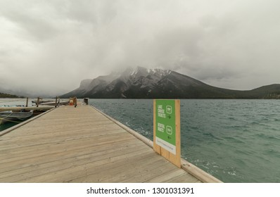 BANFF, ALBERTA September, 2017: Dock of the Lake Minnewanka Cruise with Mount Girouard behind in Banff, Alberta, Canada