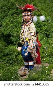 BANFF, CANADA - JUL 3: A young native Blackfoot Indian dancer gets ready for her performance during the Banff Summer Arts festival July 3, 2014. It is the longest running arts festival in Canada.