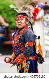 BANFF, CANADA - JUL 3: A young native Blackfoot Indian dancer gets ready for his performance during the Banff Summer Arts festival July 3, 2014. The festival is Canada's longest running arts festival.