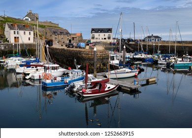 Banff, Firth, Aberdeenshire, Scotland, UK - June 17, 2018: Morning at Banff Harbour marina with docked boats and sailboats on Banff Bay Moray Firth Aberdeenshire Scotland UK