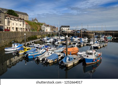 Banff, Firth, Aberdeenshire, Scotland, UK - June 17, 2018: Calm water in the morning at Banff Harbour marina with docked boats and sailboats on Banff Bay Moray Firth Aberdeenshire Scotland UK